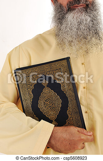 Muslim man, long beard, Koran in hand - csp5608923