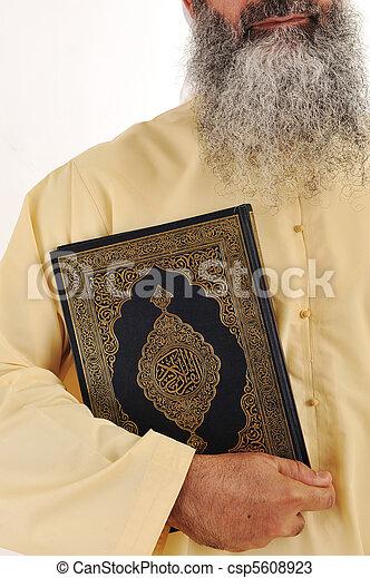 Muslim man, long beard, Koran in hand - csp5608923