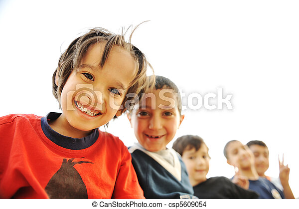 Below view of happy children embracing each other and smiling at camera - csp5609054