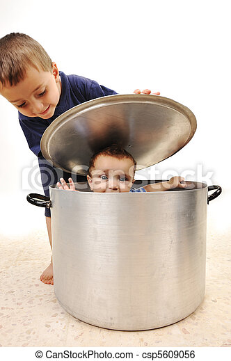 Cute child in pot, playing together, brothers - csp5609056
