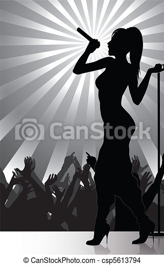 Pop singer performing on stage with - csp5613794