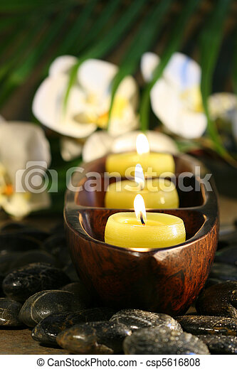 Spa setting with pebbles, candles and flowers - csp5616808