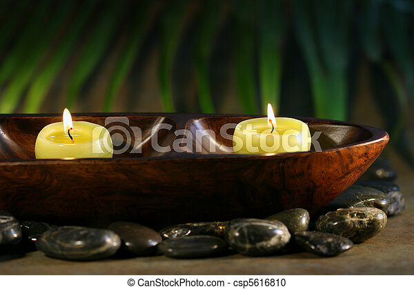 Massage stones and spa candles - csp5616810