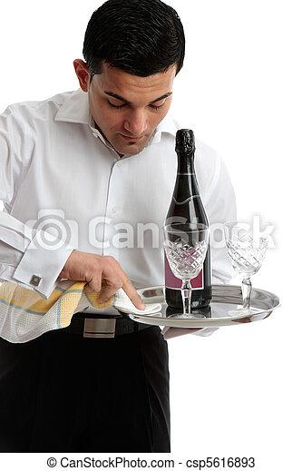 Waiter or servant preparing tray - csp5616893
