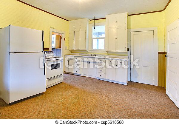Very old white and yellow kitchen in a bad condition - csp5618568