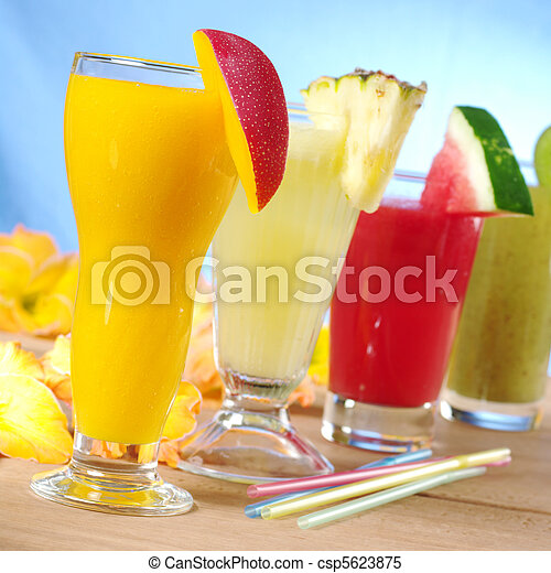 Mango, pineapple, watermelon and kiwi smoothie with drinking straws on wood (Selective Focus, Focus on the mango smoothie in the front) - csp5623875