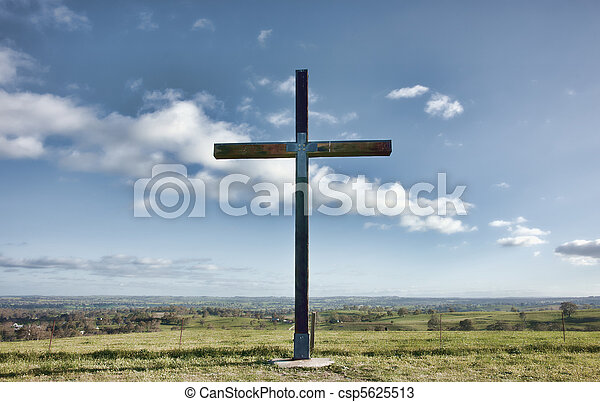 christian cross of christ in field - csp5625513