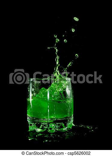Orange in green water splash