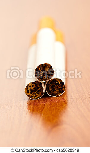 cigarette on table - csp5628349