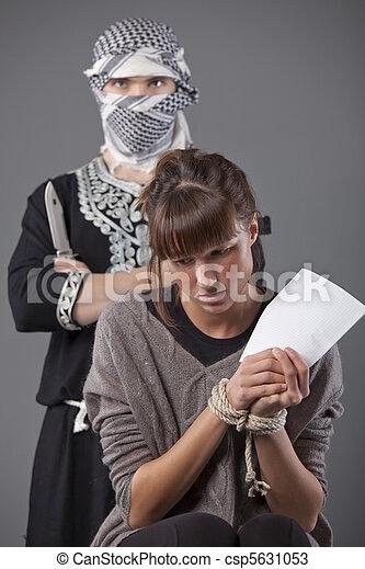 female hostage and terrorist - csp5631053