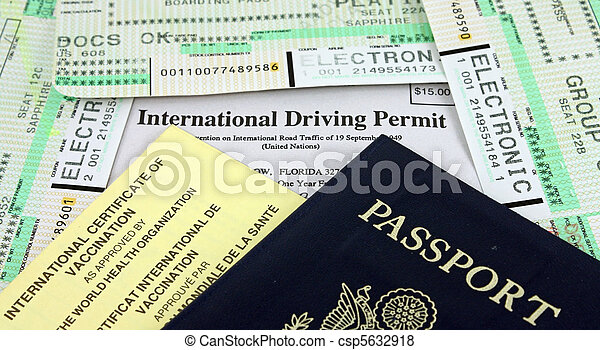 Collection of Travel Documents - Passport, International Driving Permit, International Vaccination Certificate and Airline Boarding Passes.