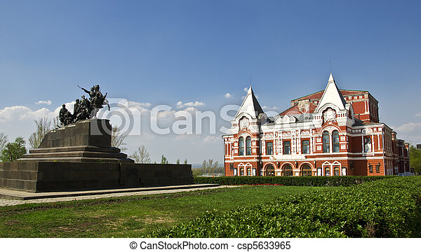 Building of the Drama Theatre, built in traditional Russian style and monument to the cavalry. Urban landscape. Russia, Samara.