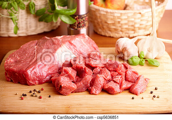 Raw beef on cutting board - csp5636851