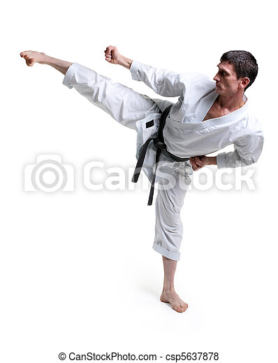 Karate. Man in a kimono hits foot - csp5637878