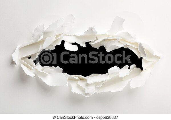 Torn hole through paper - csp5638837