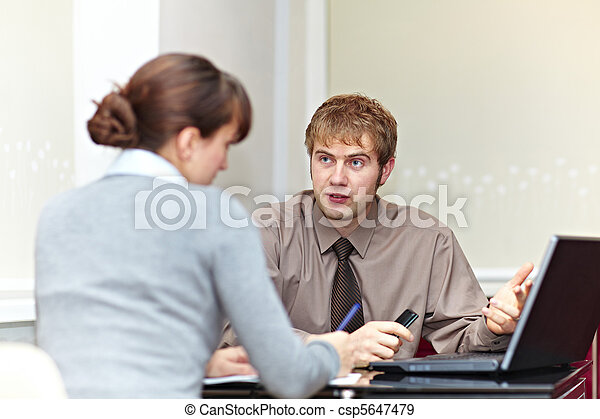 Boss talking to his secretary - csp5647479