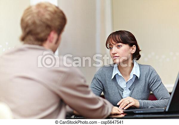 Boss talking to her employee - csp5647541