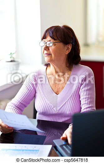 Senior woman calculating finances - csp5647818