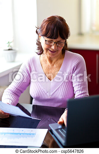 Senior woman calculating finances - csp5647826