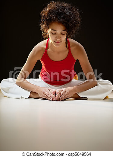 hispanic woman doing stretching and yoga - csp5649564
