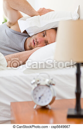 Man waking up in his bed - csp5649667