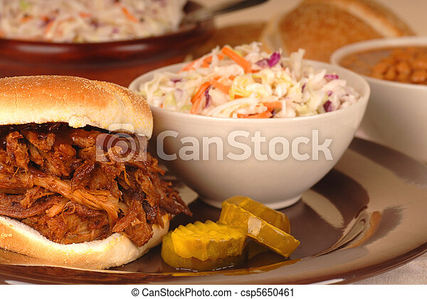 Pulled pork sandwich with cole slaw and beans - csp5650461