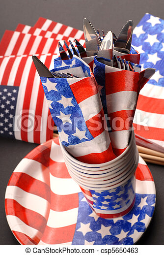 Knives and forks presented in a 4th of July theme - csp5650463