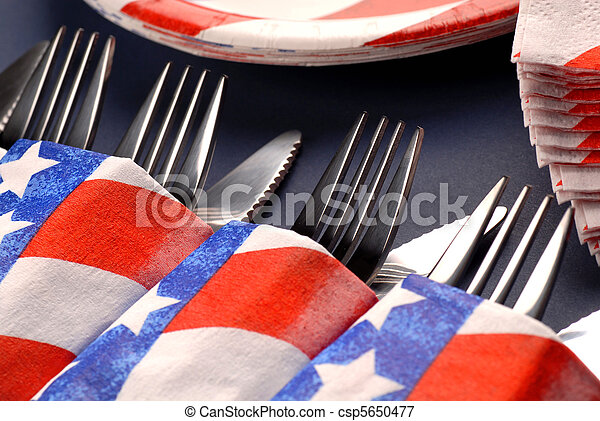 Knives and forks in a 4th of July table setting - csp5650477