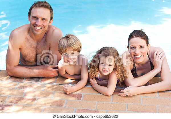 Happy family beside the swimming pool - csp5653622