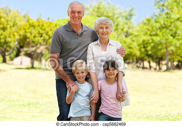 Grandparents with their grandchildren in the park - csp5662469