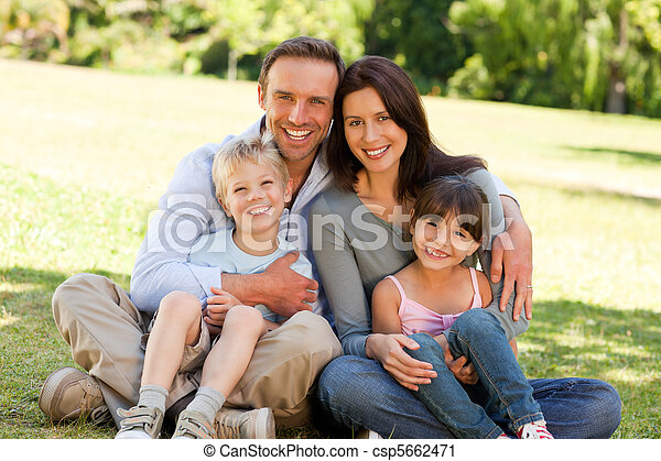 Family sitting in the park - csp5662471