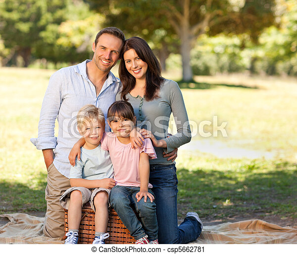 Smiling family picnicking in the park - csp5662781