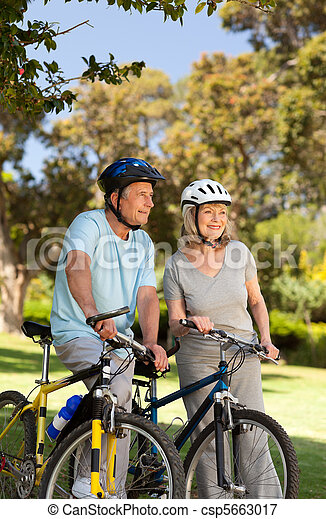 Elderly couple with their bikes - csp5663017