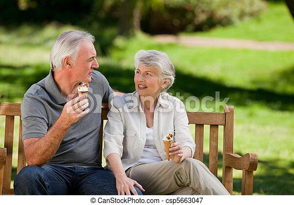 Senior couple eating an ice cream o - csp5663047