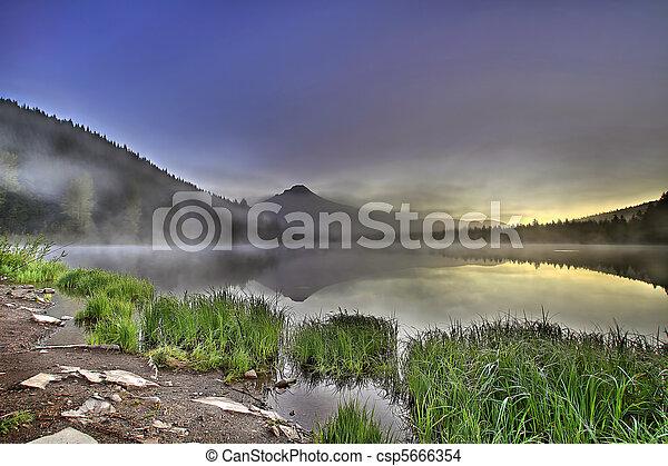 Foggy Sunrise at Trillium Lake with Mount Hood - csp5666354