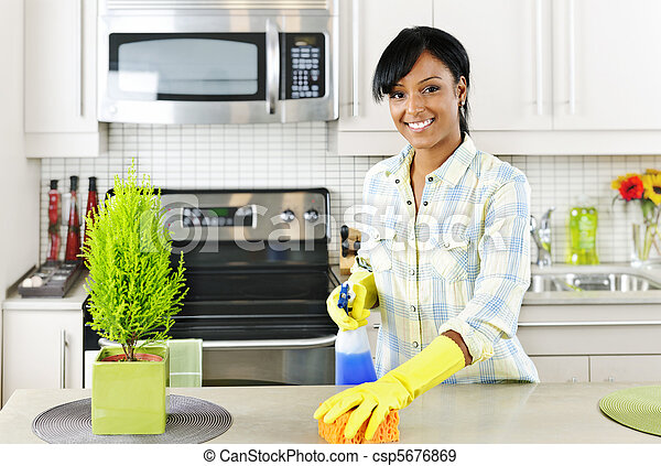 Young woman cleaning kitchen - csp5676869