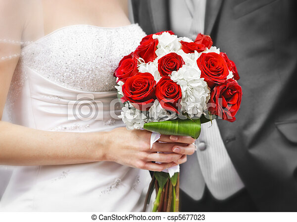 Bride and groom with bridal bouquet - csp5677023