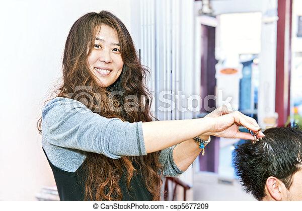 Hair stylist working - csp5677209