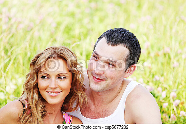 Stock photo of lovers on grass field two lovers on grass for 2 lovers pic