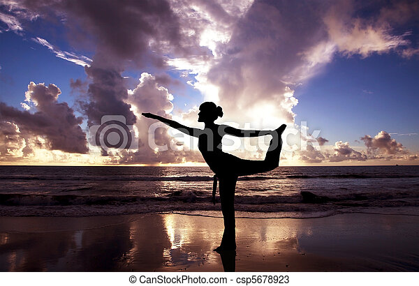 Yoga woman on the beautiful beach at sunrise - csp5678923