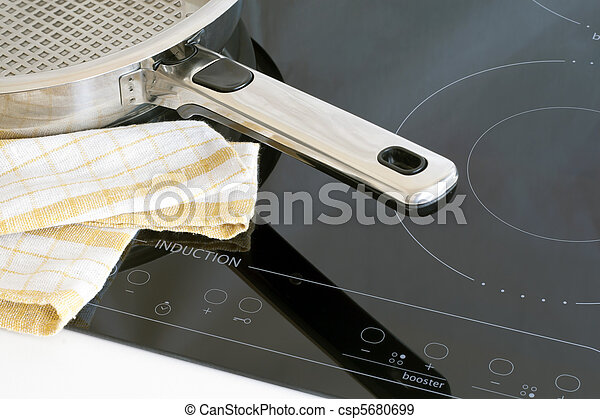Kitchen utensils, pots and induction hobs.  - csp5680699