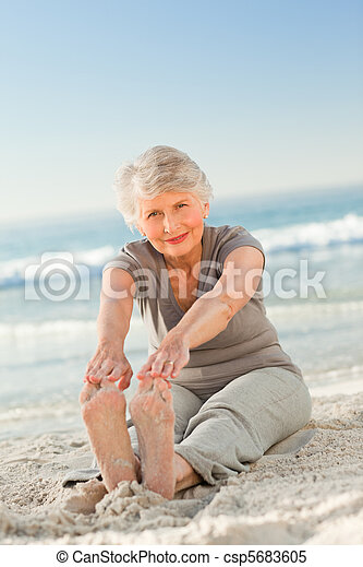Elderly woman doing her streches - csp5683605