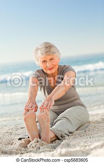 Elderly woman doing her streches - csp5683605