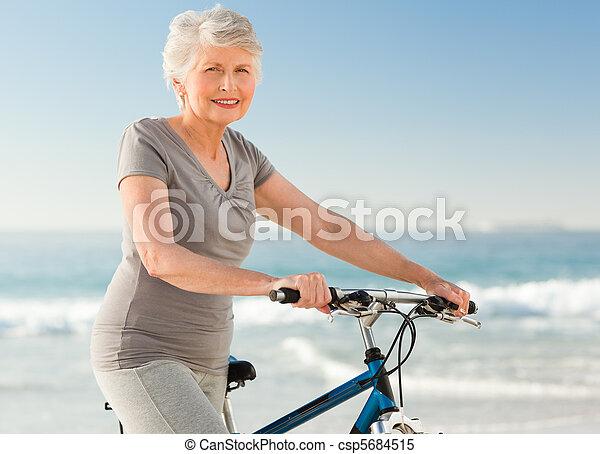 Senior woman with her bike - csp5684515
