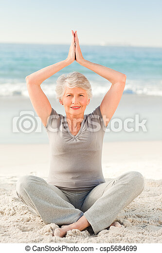 Elderly woman doing her streches - csp5684699