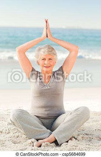 Elderly woman doing her streches - csp5684699