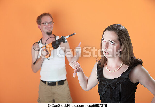 Woman Unhappy with Man's Work - csp5687376