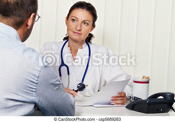 Doctors in medical practice with patients.  - csp5689263