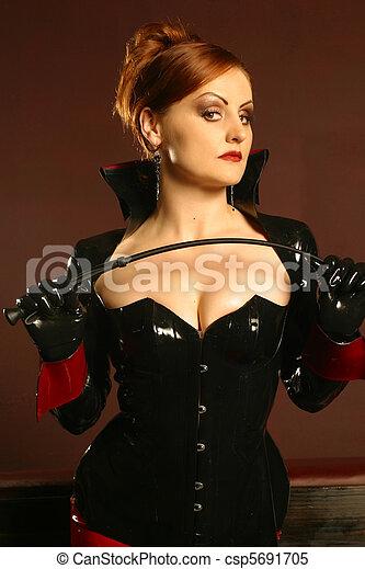 Portrait of redhead dominatrix - csp5691705