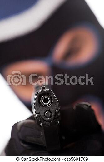 Ski Masked Criminal Pointing a Gun - csp5691709